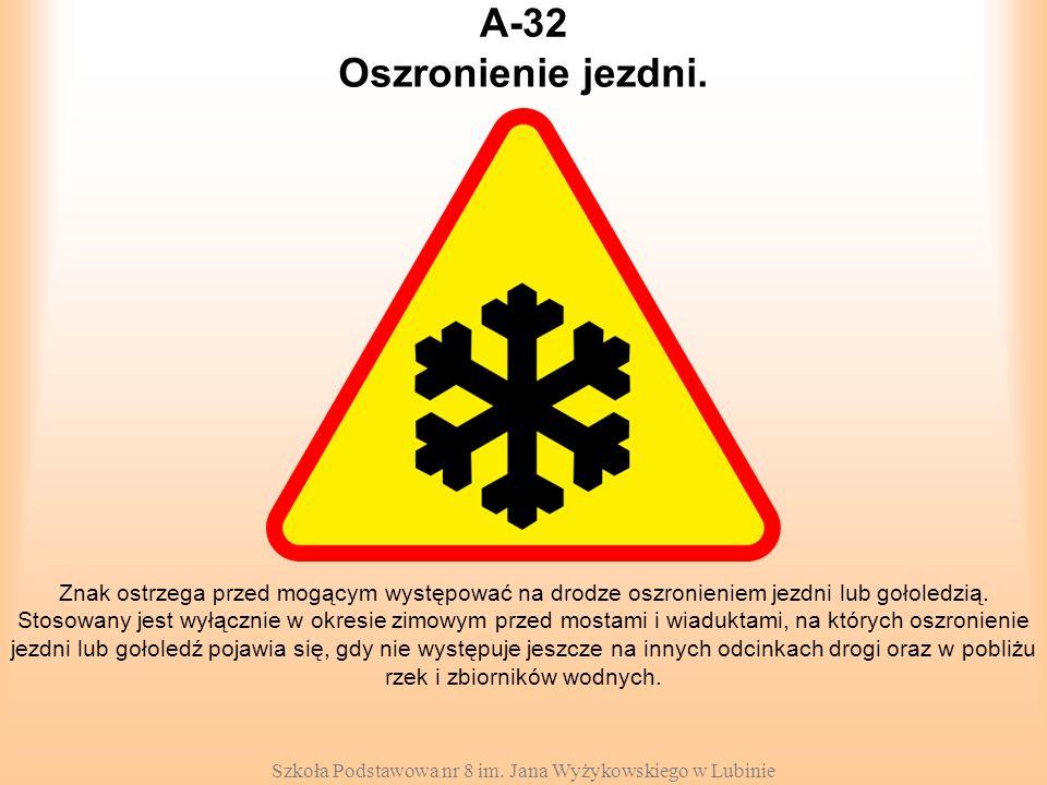 Szkoła Podstawowa nr 8 im. Jana Wyżykowskiego w Lubinie A-32 Znak ostrzega przed mogącym występować na drodze oszronieniem jezdni lub gołoledzią. Stos
