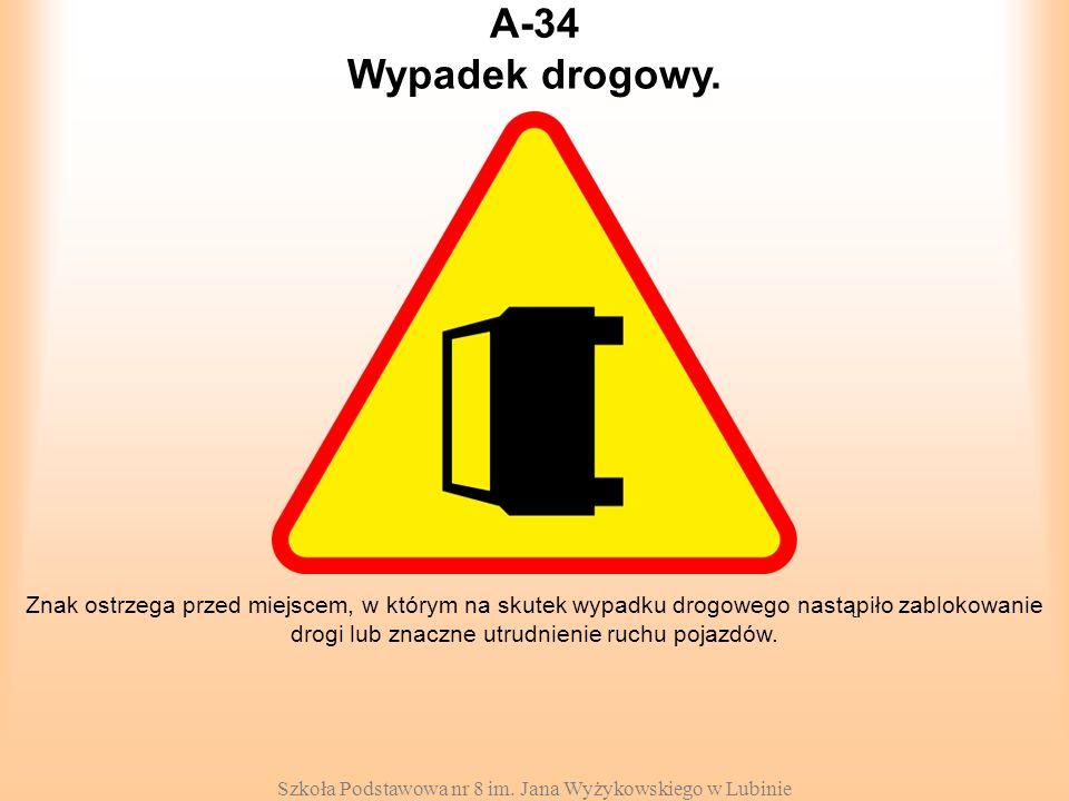 Szkoła Podstawowa nr 8 im. Jana Wyżykowskiego w Lubinie A-34 Znak ostrzega przed miejscem, w którym na skutek wypadku drogowego nastąpiło zablokowanie