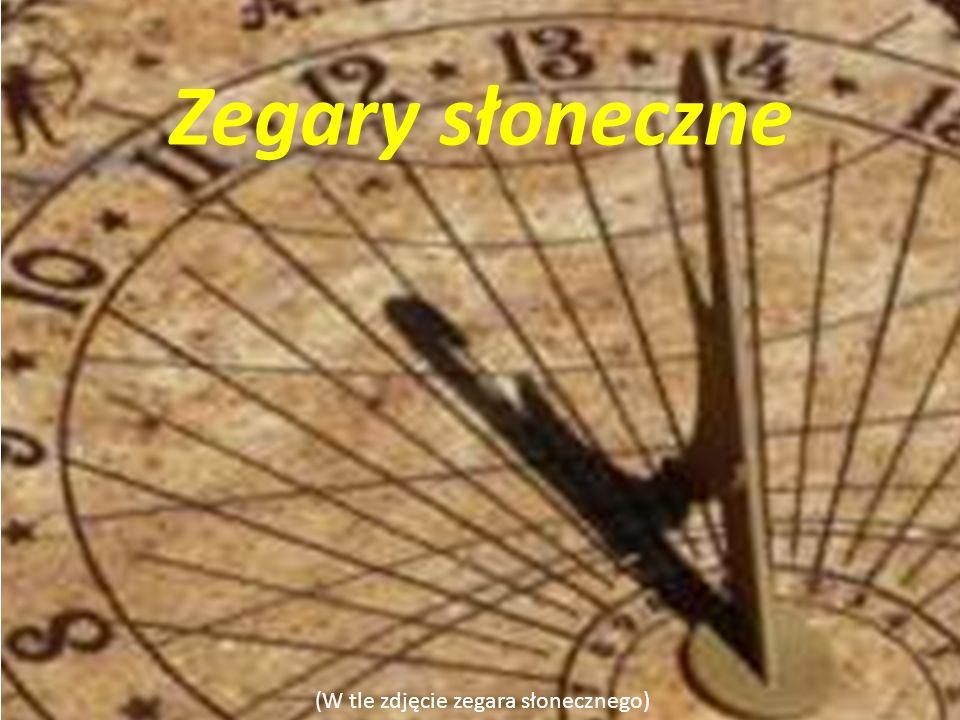 (W tle zdjęcie zegara słonecznego) Zegary słoneczne (Zdjęcie zegara słonecznego z tarczą ) Konstrukcja najprostszego takiego zegara to wbity w ziemię palik (gnomon).