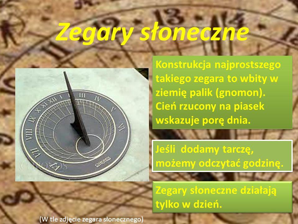 (W tle zdjęcie zegara słonecznego) Zegary słoneczne (Zdjęcie zegara słonecznego z tarczą ) Konstrukcja najprostszego takiego zegara to wbity w ziemię