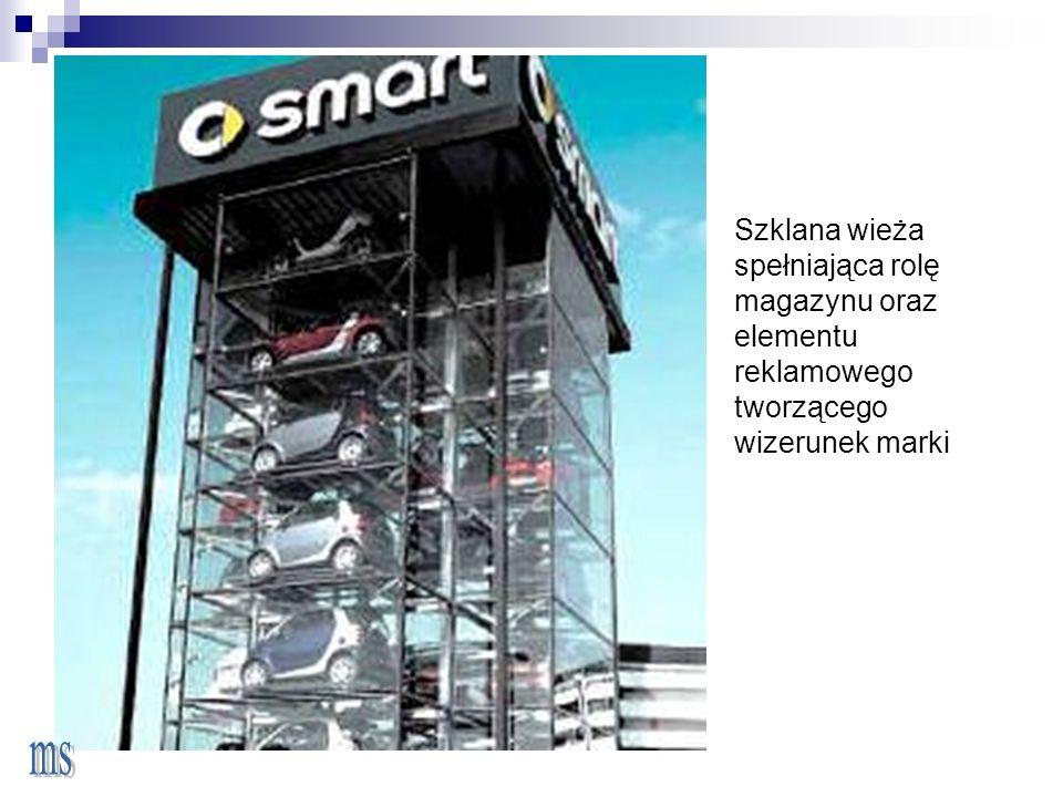 Szklana wieża spełniająca rolę magazynu oraz elementu reklamowego tworzącego wizerunek marki