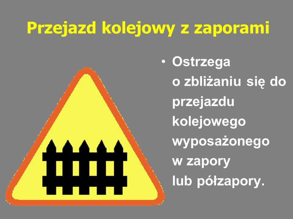 Przejazd kolejowy z zaporami Ostrzega o zbliżaniu się do przejazdu kolejowego wyposażonego w zapory lub półzapory.