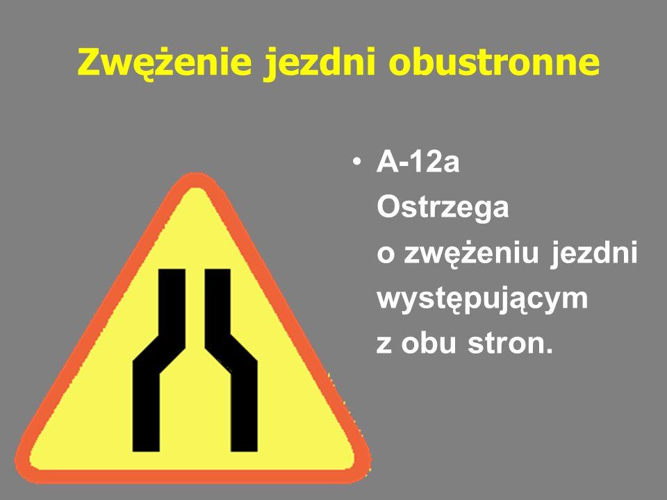 Zwężenie jezdni obustronne A-12a Ostrzega o zwężeniu jezdni występującym z obu stron.