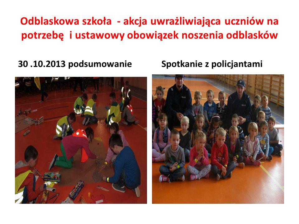 Odblaskowa szkoła - akcja uwrażliwiająca uczniów na potrzebę i ustawowy obowiązek noszenia odblasków 30.10.2013 podsumowanie Spotkanie z policjantami