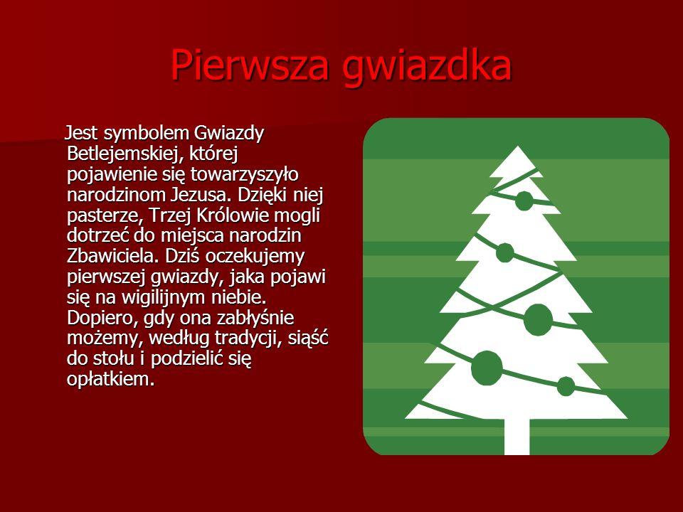 Opłatek Na nim widnieją obrazy związane z Bożym Narodzeniem.