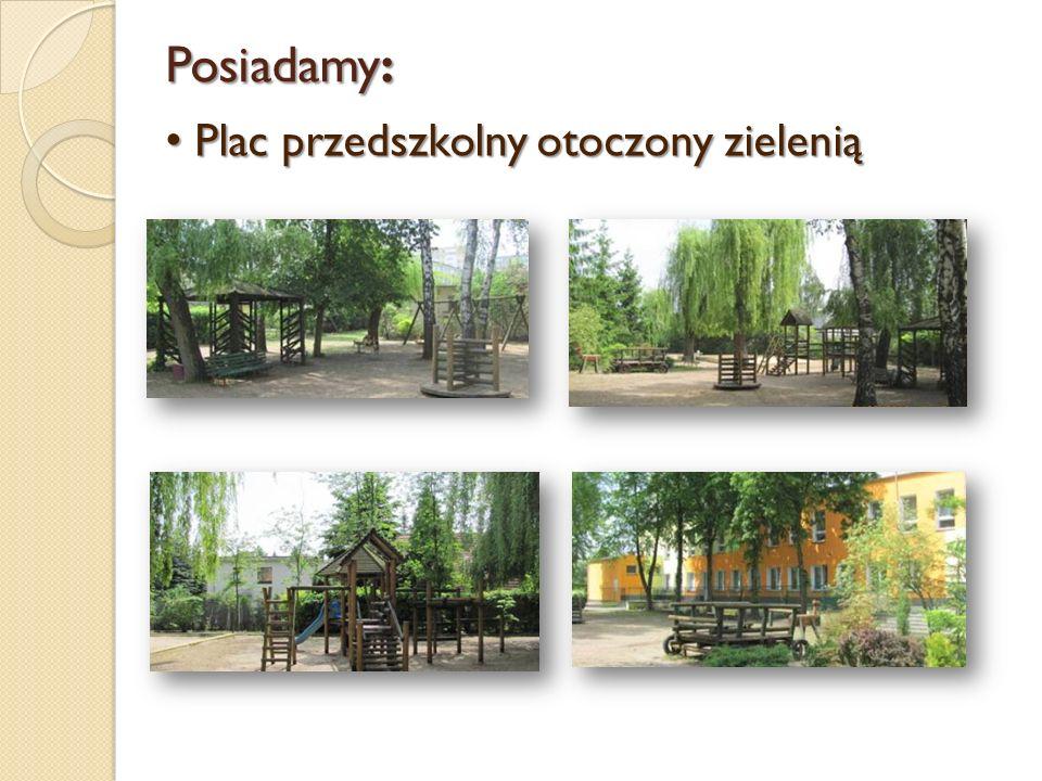 Posiadamy: Plac przedszkolny otoczony zielenią Plac przedszkolny otoczony zielenią