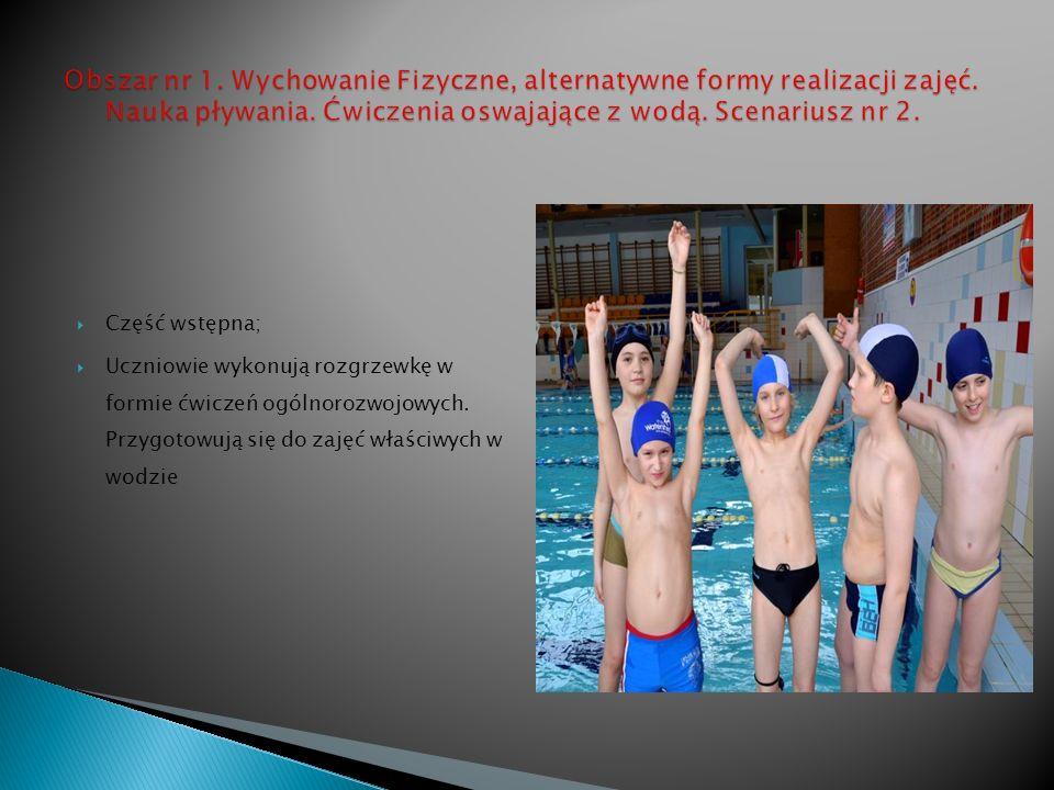 Część wstępna; Uczniowie wykonują rozgrzewkę w formie ćwiczeń ogólnorozwojowych.
