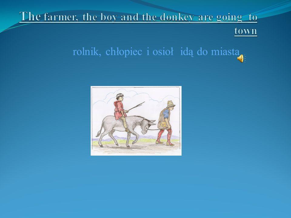rolnik, chłopiec i osioł idą do miasta