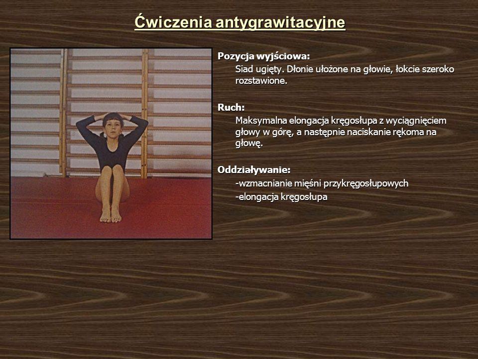 Ćwiczenia antygrawitacyjne Pozycja wyjściowa: Siad ugięty. Dłonie ułożone na głowie, łokcie szeroko rozstawione. Ruch: Maksymalna elongacja kręgosłupa