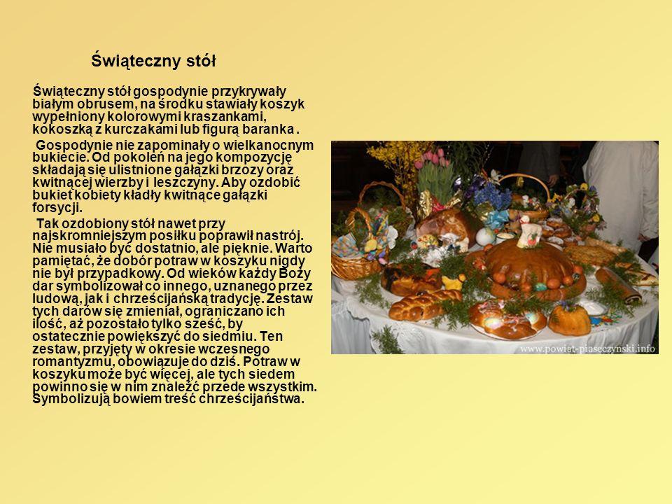 Świąteczny stół Świąteczny stół gospodynie przykrywały białym obrusem, na środku stawiały koszyk wypełniony kolorowymi kraszankami, kokoszką z kurczak