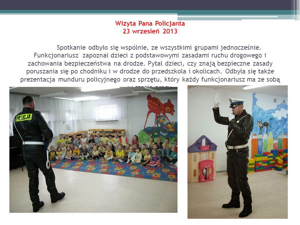Wizyta Pana Policjanta 23 wrzesień 2013 Spotkanie odbyło się wspólnie, ze wszystkimi grupami jednocześnie. Funkcjonariusz zapoznał dzieci z podstawowy