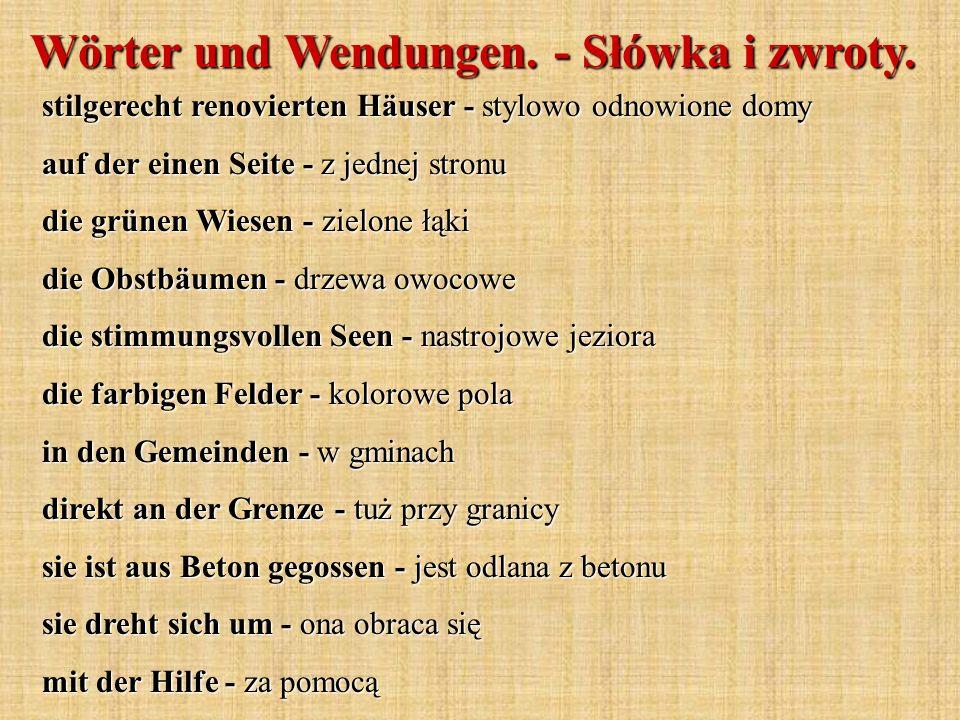 Wörter und Wendungen. - Słówka i zwroty. stilgerecht renovierten Häuser - stylowo odnowione domy auf der einen Seite - z jednej stronu die grünen Wies