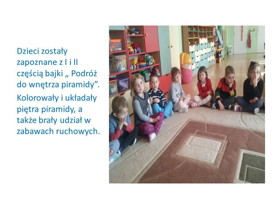 Dzieci zostały zapoznane z I i II częścią bajki Podróż do wnętrza piramidy. Kolorowały i układały piętra piramidy, a także brały udział w zabawach ruc
