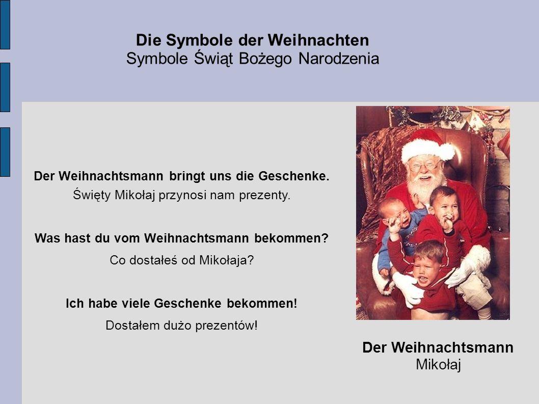 Die Symbole der Weihnachten Symbole Świąt Bożego Narodzenia Der Weihnachtsmann Mikołaj Der Weihnachtsmann bringt uns die Geschenke. Święty Mikołaj prz