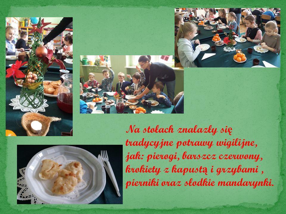 Na stołach znalazły si ę tradycyjne potrawy wigilijne, jak: pierogi, barszcz czerwony, krokiety z kapust ą i grzybami, pierniki oraz słodkie mandarynki.