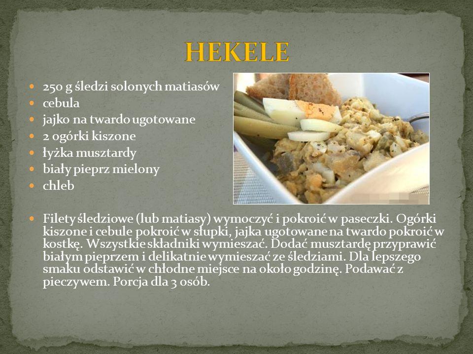 250 g śledzi solonych matiasów cebula jajko na twardo ugotowane 2 ogórki kiszone łyżka musztardy biały pieprz mielony chleb Filety śledziowe (lub mati