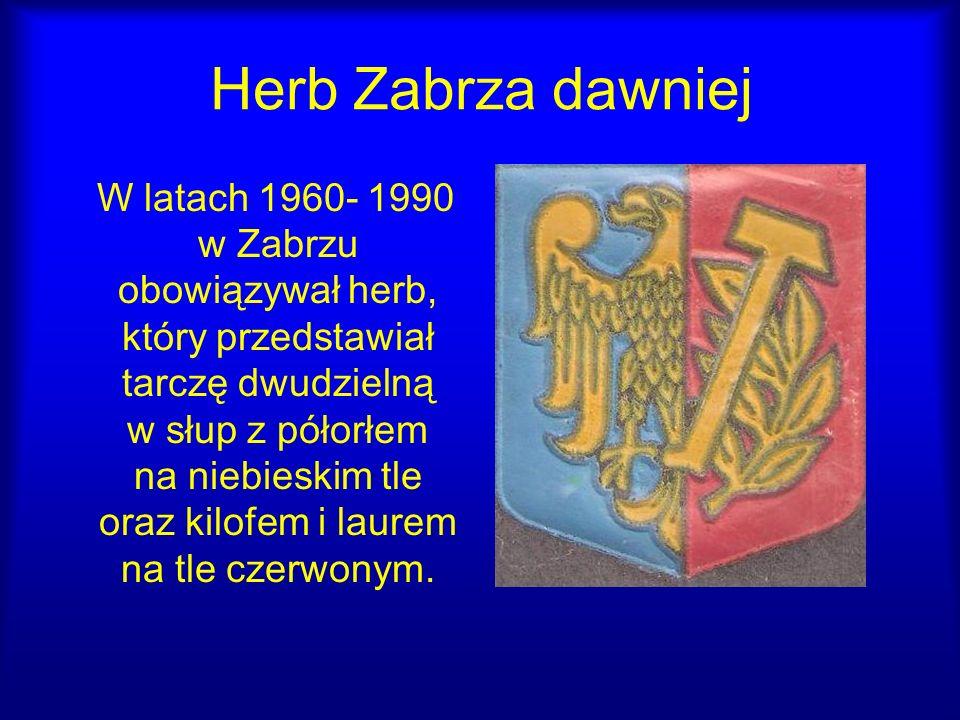 Herb Zabrza dawniej W latach 1960- 1990 w Zabrzu obowiązywał herb, który przedstawiał tarczę dwudzielną w słup z półorłem na niebieskim tle oraz kilof