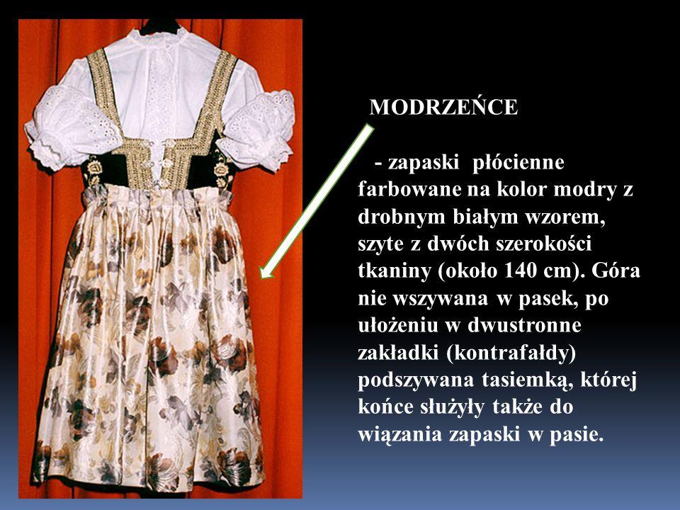 MODRZEŃCE - zapaski płócienne farbowane na kolor modry z drobnym białym wzorem, szyte z dwóch szerokości tkaniny (około 140 cm).