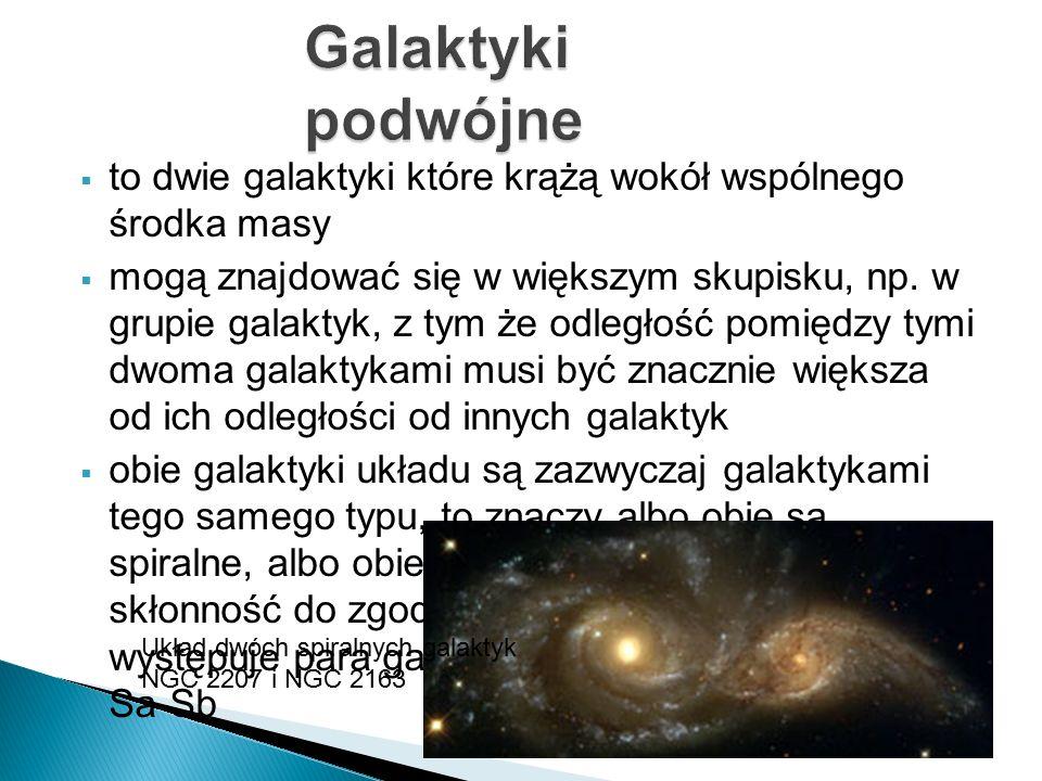  to dwie galaktyki które krążą wokół wspólnego środka masy  mogą znajdować się w większym skupisku, np. w grupie galaktyk, z tym że odległość pomięd