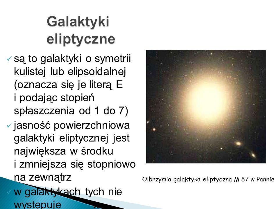są to galaktyki o symetrii kulistej lub elipsoidalnej (oznacza się je literą E i podając stopień spłaszczenia od 1 do 7) jasność powierzchniowa galaktyki eliptycznej jest największa w środku i zmniejsza się stopniowo na zewnątrz w galaktykach tych nie występuje w zauważalnych ilościach pył i gaz Olbrzymia galaktyka eliptyczna M 87 w Pannie
