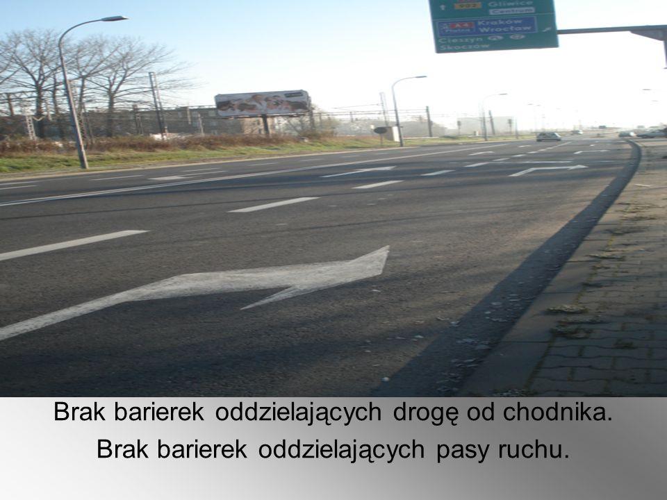 Brak barierek oddzielających drogę od chodnika. Brak barierek oddzielających pasy ruchu.