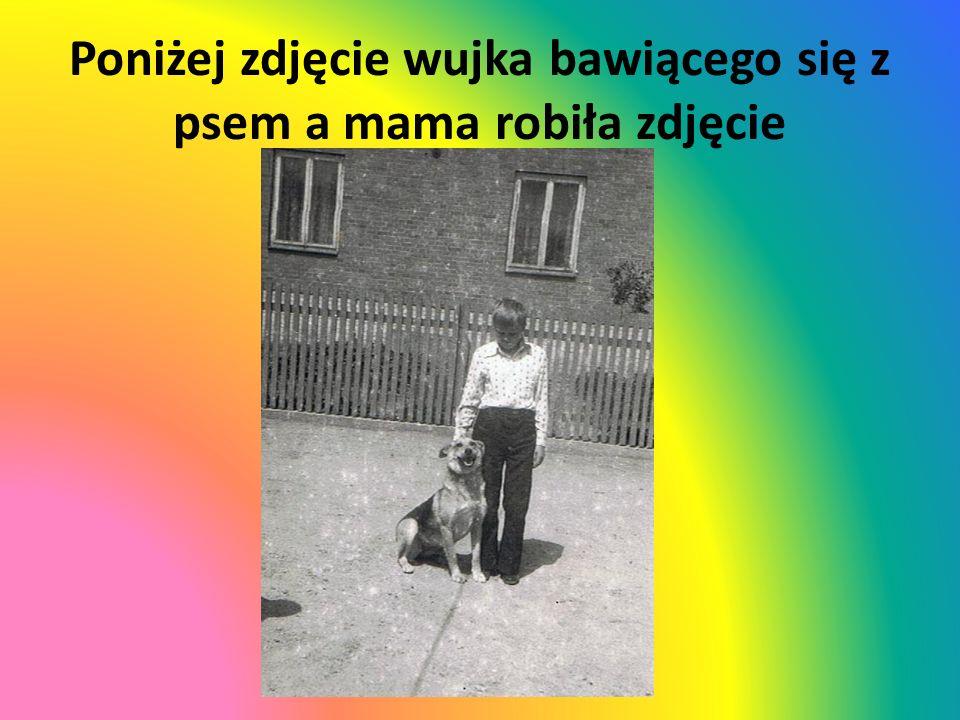 Poniżej zdjęcie wujka bawiącego się z psem a mama robiła zdjęcie