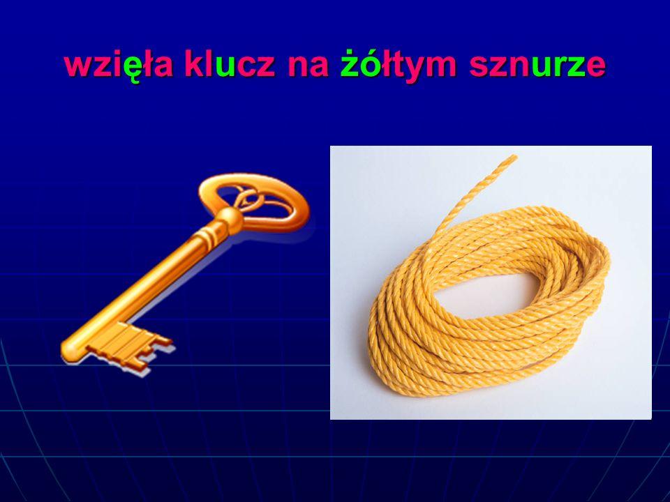 wzięła klucz na żółtym sznurze