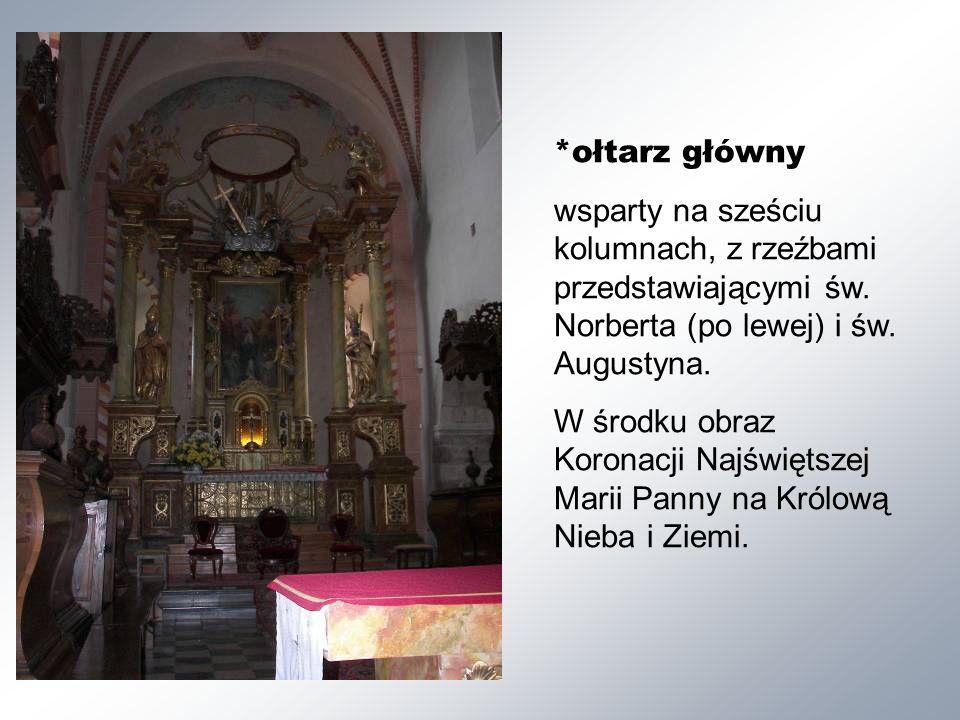 *ołtarz główny wsparty na sześciu kolumnach, z rzeźbami przedstawiającymi św.