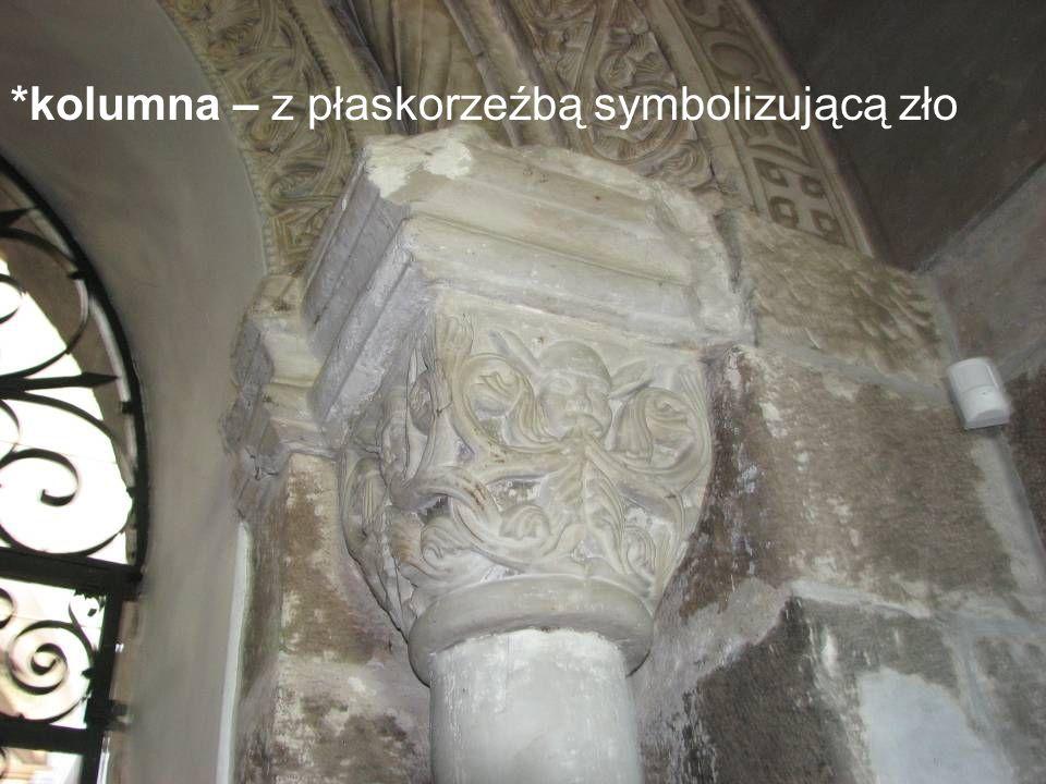 *kolumna – z płaskorzeźbą symbolizującą zło