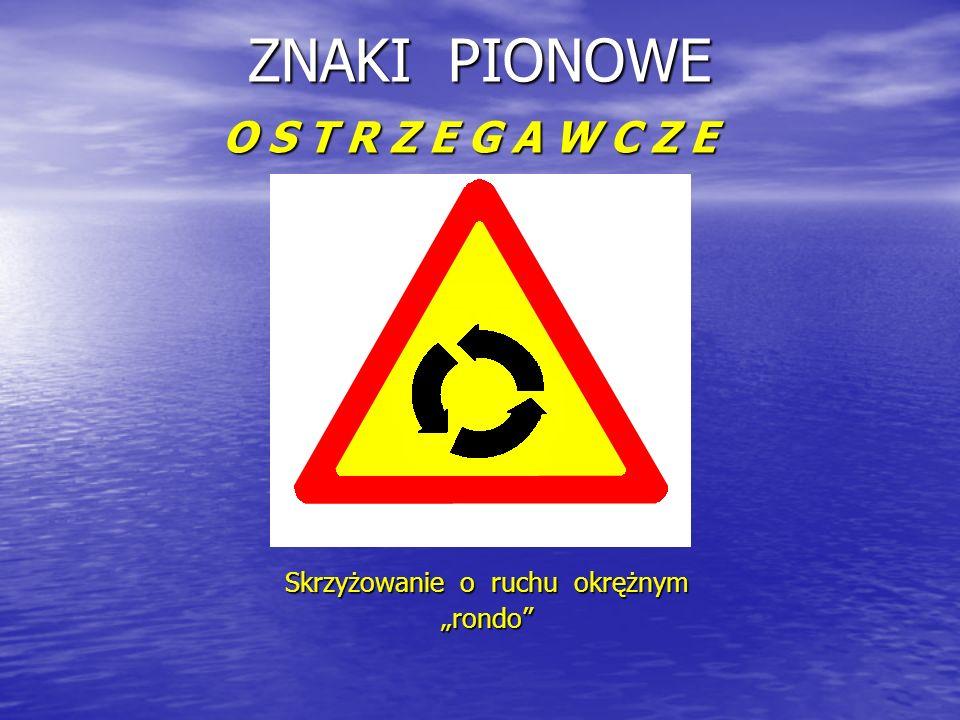 "ZNAKI PIONOWE O S T R Z E G A W C Z E Skrzyżowanie o ruchu okrężnym ""rondo"
