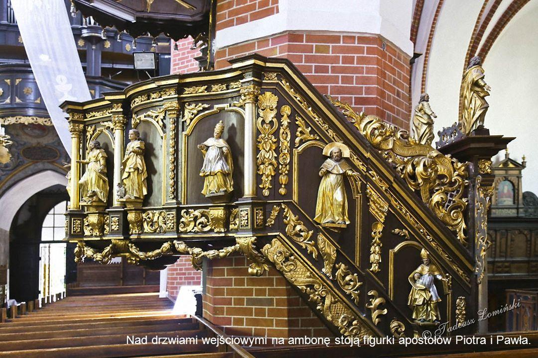 Barokowa chrzcielnica Pomiędzy kolumnami w stylu korynckim widoczna jest ażurowa dekoracja z liści przeplatanych wstęgami. Na głównym gzymsie umieszcz