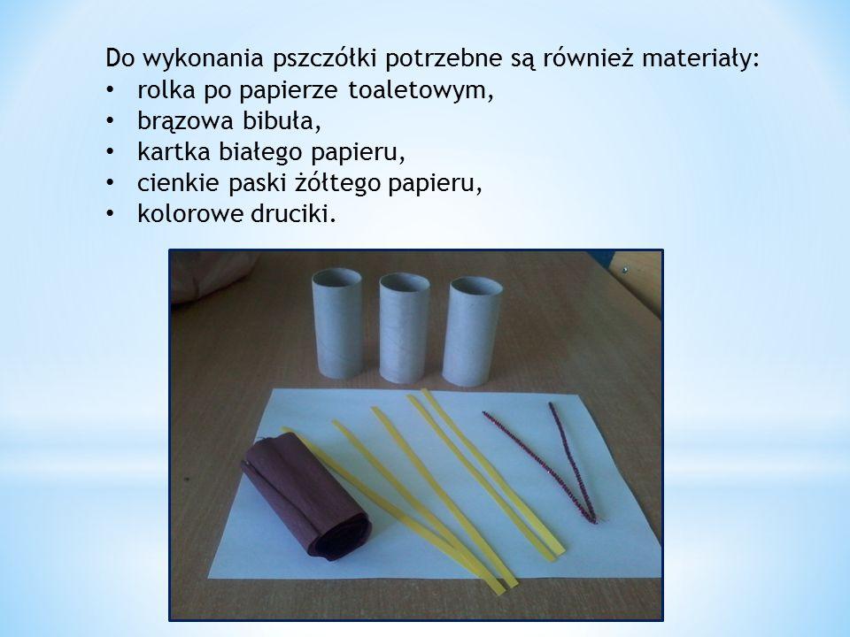 Do wykonania pszczółki potrzebne są również materiały: rolka po papierze toaletowym, brązowa bibuła, kartka białego papieru, cienkie paski żółtego papieru, kolorowe druciki.