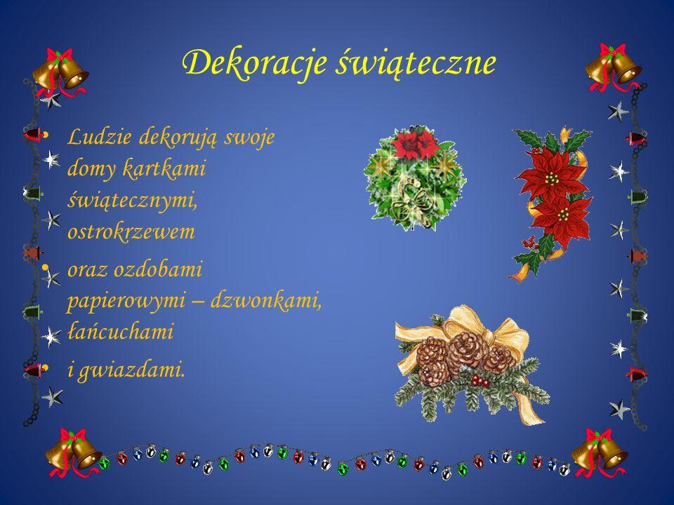 Dekoracje świąteczne Ludzie dekorują swoje domy kartkami świątecznymi, ostrokrzewem oraz ozdobami papierowymi – dzwonkami, łańcuchami i gwiazdami.
