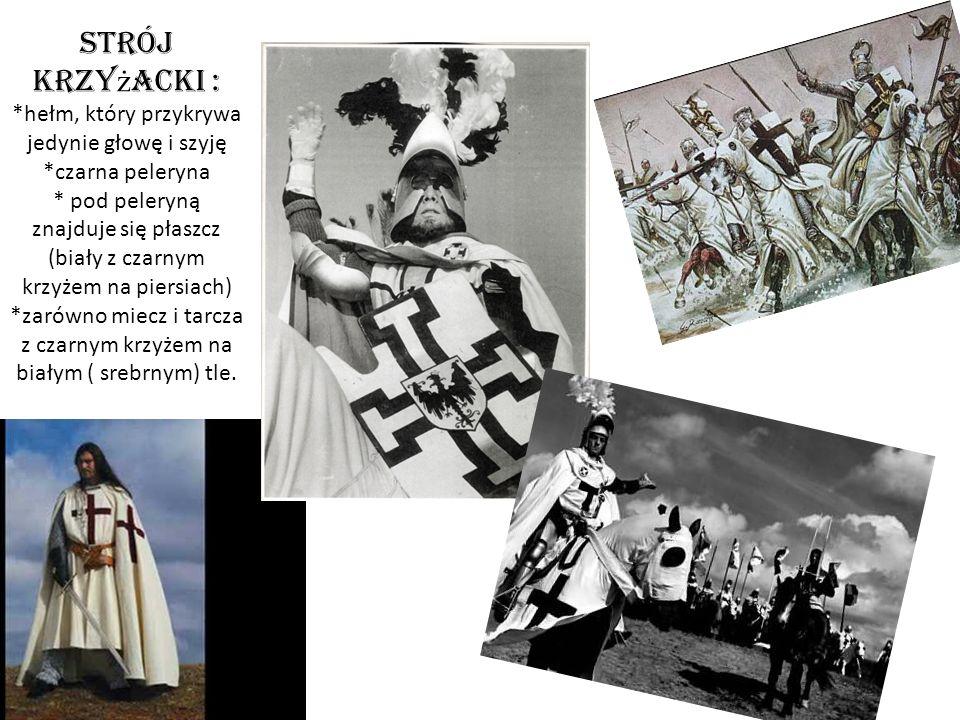 Strój krzy ż acki : *hełm, który przykrywa jedynie głowę i szyję *czarna peleryna * pod peleryną znajduje się płaszcz (biały z czarnym krzyżem na piersiach) *zarówno miecz i tarcza z czarnym krzyżem na białym ( srebrnym) tle.
