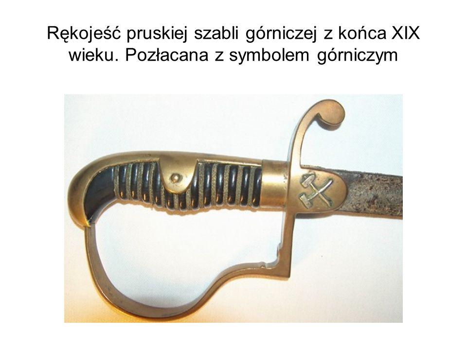 Rękojeść pruskiej szabli górniczej z końca XIX wieku. Pozłacana z symbolem górniczym