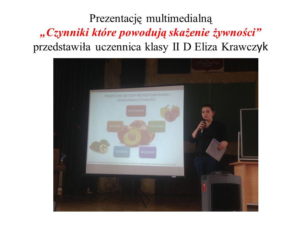 """Prezentację multimedialną """"Czynniki które powodują skażenie żywności przedstawiła uczennica klasy II D Eliza Krawcz yk"""