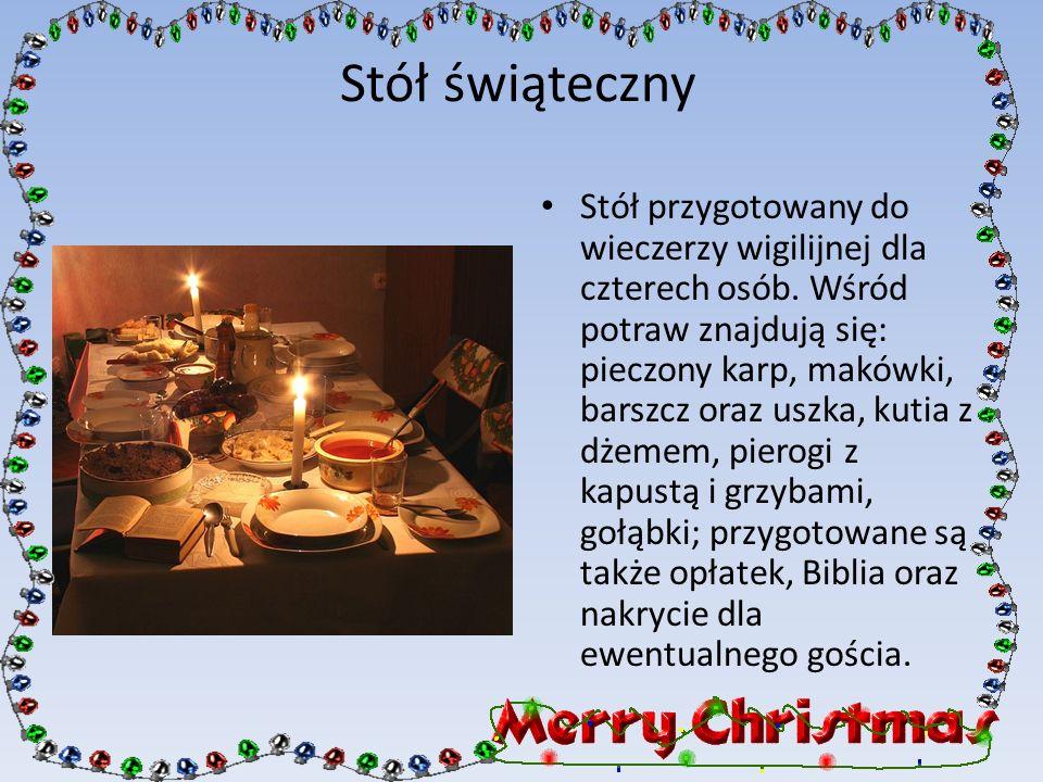 Stół świąteczny Stół przygotowany do wieczerzy wigilijnej dla czterech osób. Wśród potraw znajdują się: pieczony karp, makówki, barszcz oraz uszka, ku