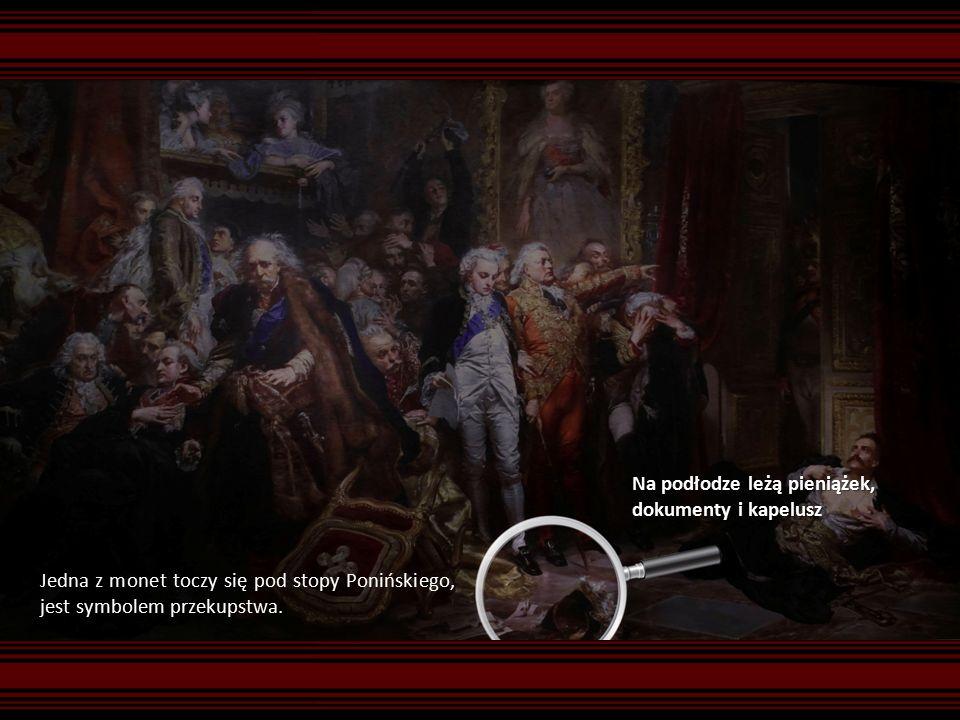 Na podłodze leżą pieniążek, dokumenty i kapelusz Jedna z monet toczy się pod stopy Ponińskiego, jest symbolem przekupstwa.