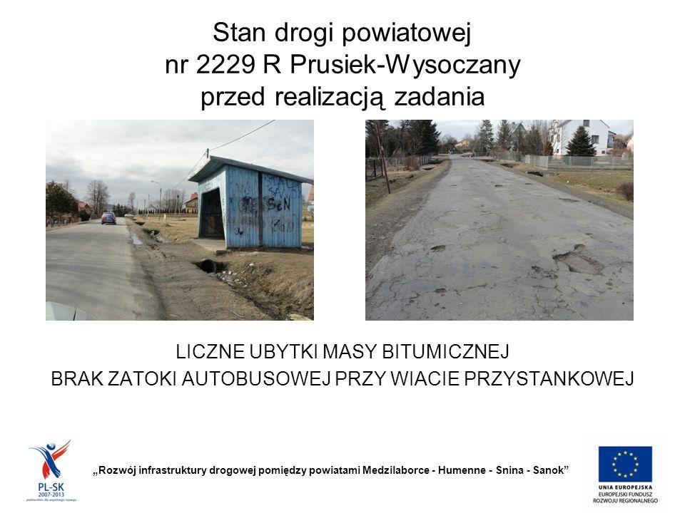 """Stan drogi powiatowej nr 2229 R Prusiek-Wysoczany przed realizacją zadania """"Rozwój infrastruktury drogowej pomiędzy powiatami Medzilaborce - Humenne - Snina - Sanok BRAK UTWARDZONYCH POBOCZY"""