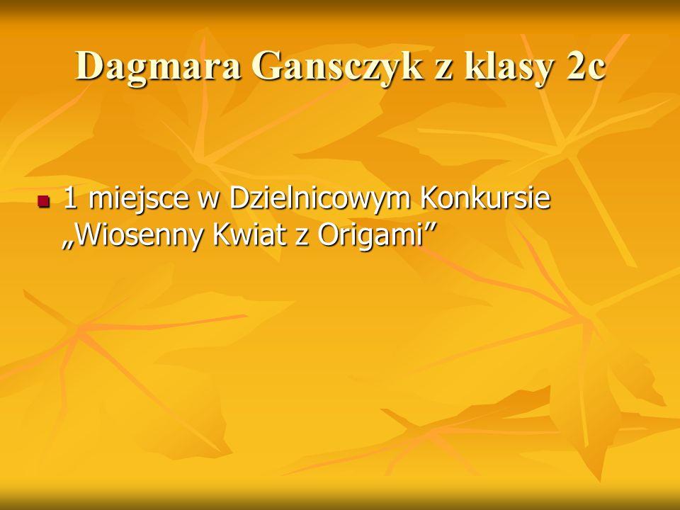 """Dagmara Gansczyk z klasy 2c 1 miejsce w Dzielnicowym Konkursie """"Wiosenny Kwiat z Origami"""" 1 miejsce w Dzielnicowym Konkursie """"Wiosenny Kwiat z Origami"""