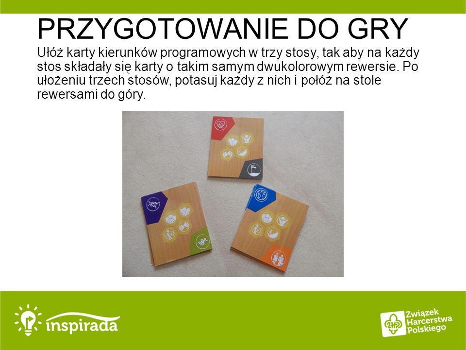 PRZYGOTOWANIE DO GRY Ułóż karty kierunków programowych w trzy stosy, tak aby na każdy stos składały się karty o takim samym dwukolorowym rewersie.
