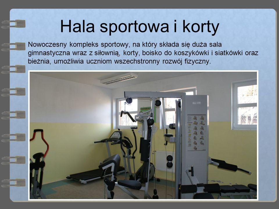 Hala sportowa i korty Nowoczesny kompleks sportowy, na który składa się duża sala gimnastyczna wraz z siłownią, korty, boisko do koszykówki i siatkówk