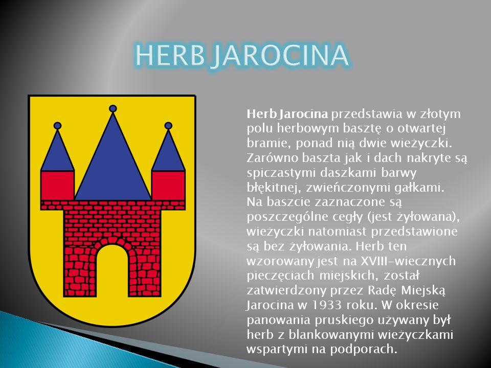 Herb Jarocina przedstawia w złotym polu herbowym basztę o otwartej bramie, ponad nią dwie wieżyczki.