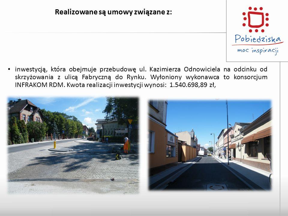 Realizowane są umowy związane z: inwestycją, która obejmuje przebudowę ul. Kazimierza Odnowiciela na odcinku od skrzyżowania z ulicą Fabryczną do Rynk