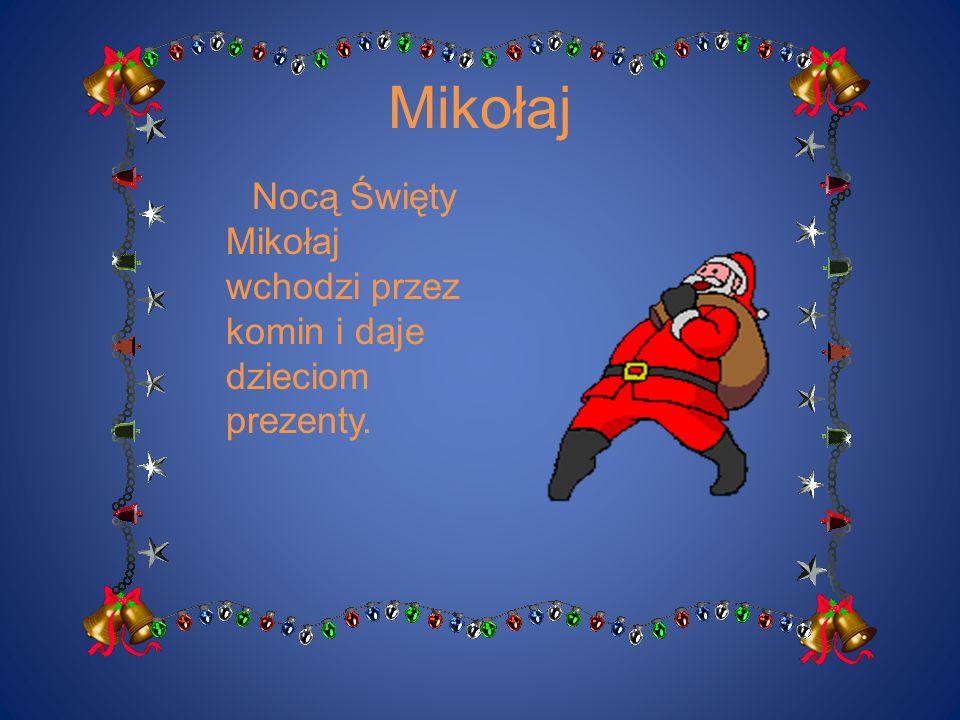 Mikołaj Nocą Święty Mikołaj wchodzi przez komin i daje dzieciom prezenty.