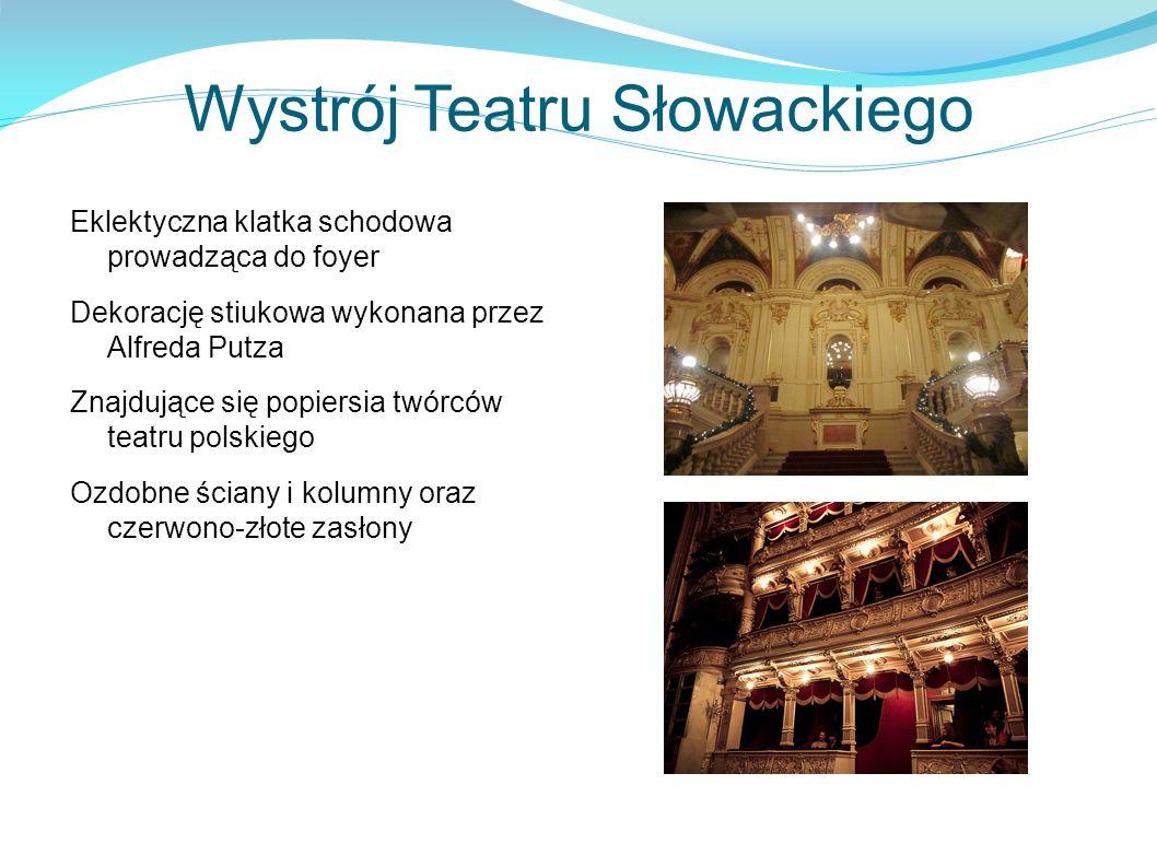 Wystrój Teatru Słowackiego Eklektyczna klatka schodowa prowadząca do foyer Dekorację stiukowa wykonana przez Alfreda Putza Znajdujące się popiersia twórców teatru polskiego Ozdobne ściany i kolumny oraz czerwono-złote zasłony