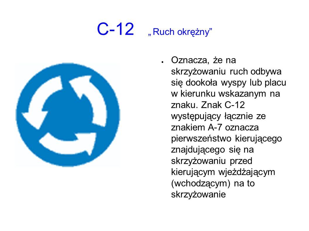 """C-12 """"Ruch okrężny ● Oznacza, że na skrzyżowaniu ruch odbywa się dookoła wyspy lub placu w kierunku wskazanym na znaku."""