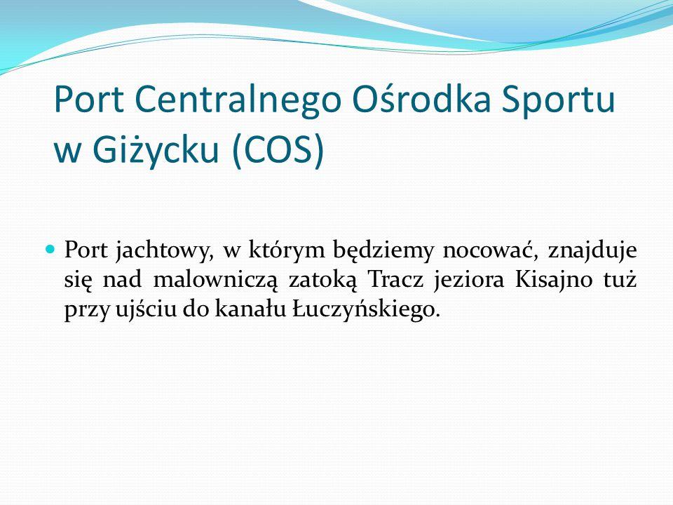 Port Centralnego Ośrodka Sportu w Giżycku (COS) Port jachtowy, w którym będziemy nocować, znajduje się nad malowniczą zatoką Tracz jeziora Kisajno tuż