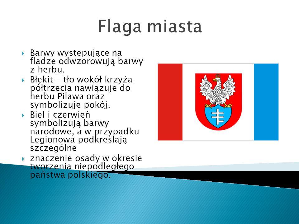Flaga miasta  Barwy występujące na fladze odwzorowują barwy z herbu.  Błękit – tło wokół krzyża półtrzecia nawiązuje do herbu Pilawa oraz symbolizuj