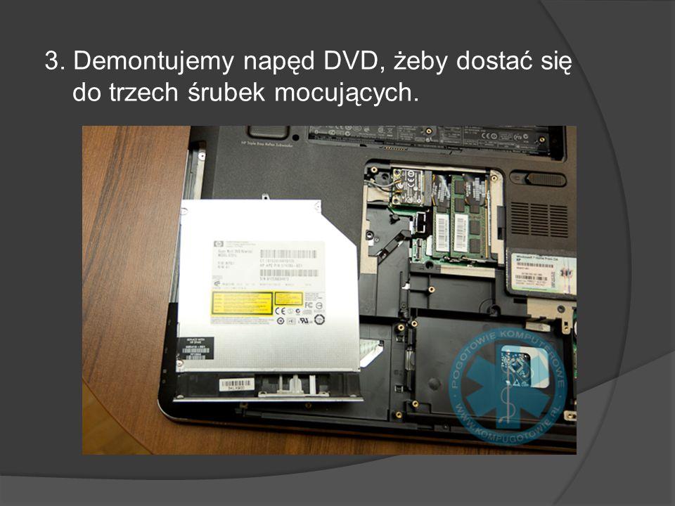 3. Demontujemy napęd DVD, żeby dostać się do trzech śrubek mocujących.